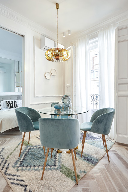 Inspiration for a contemporary beige floor dining room remodel in Madrid with white walls