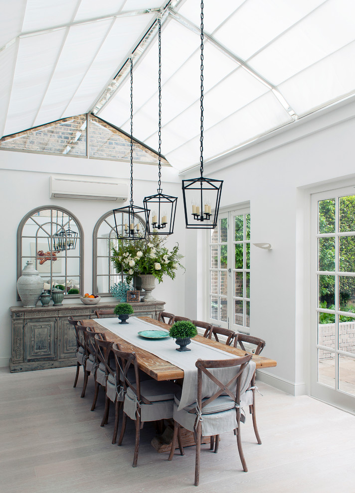 Medium sized rural conservatory in London with no fireplace, a glass ceiling, grey floors and light hardwood flooring.