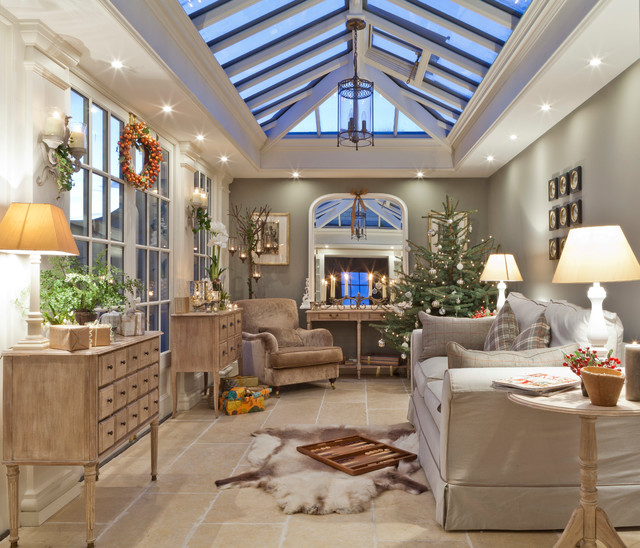 This is an example of a medium sized traditional conservatory in Other with travertine flooring, a skylight and beige floors.