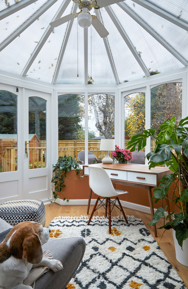 Sunroom - transitional light wood floor and beige floor sunroom idea in London with a glass ceiling