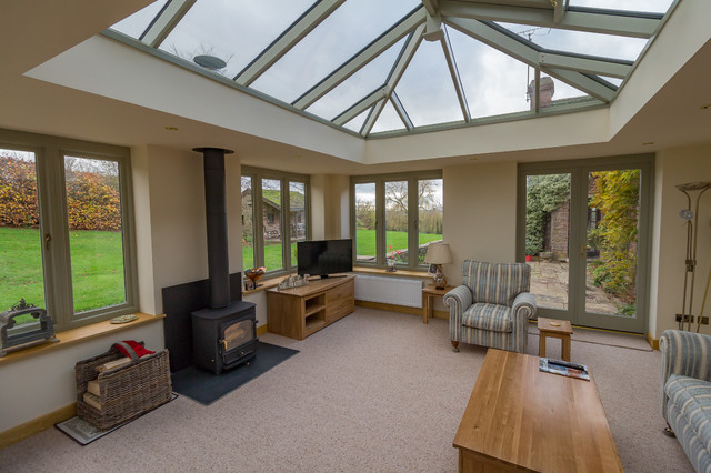 Linked living room orangery style with woodburner modern for Wooden garden rooms extensions