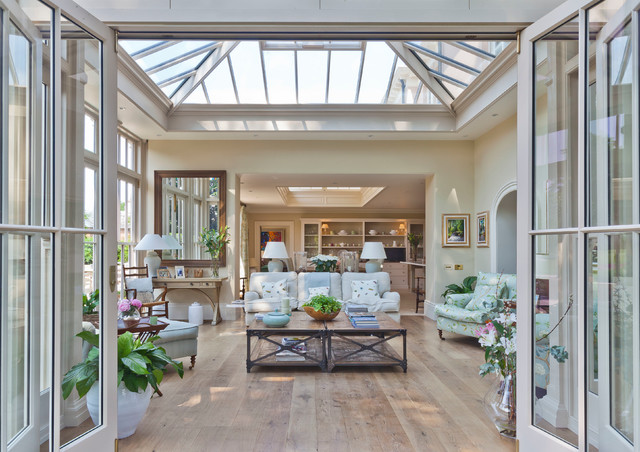 Orangery with bi fold doors traditional sunroom for Orangery lighting ideas