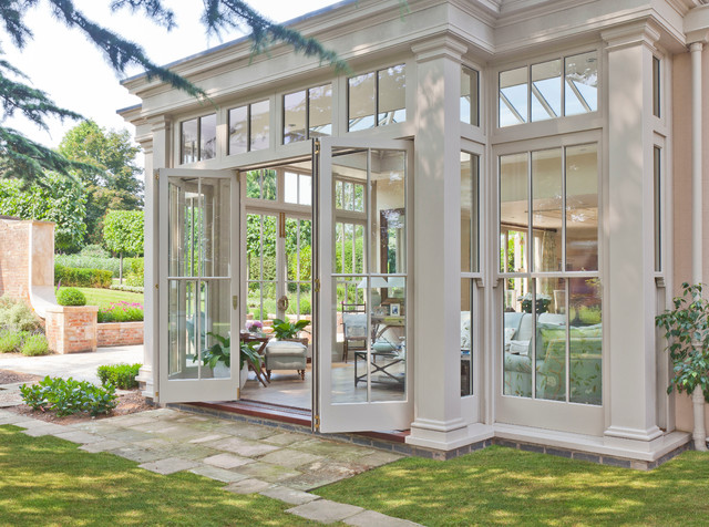 Orangery with bi fold doors traditional sunroom for Conservatory doors exterior
