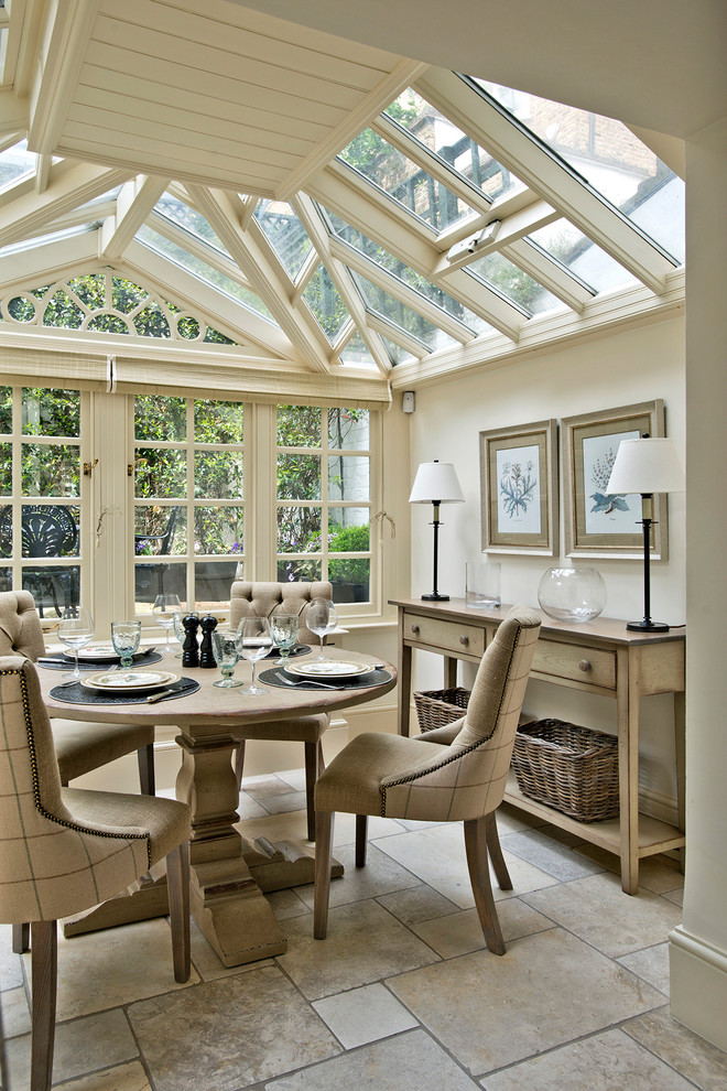 Mid-sized elegant sunroom photo in London with a glass ceiling