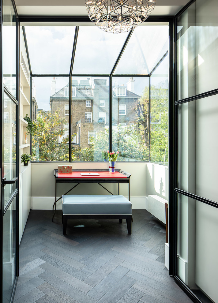 Example of a trendy sunroom design in London