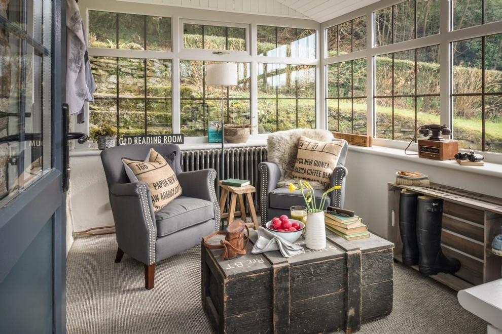 Mid-sized farmhouse carpeted and gray floor sunroom photo in Cornwall with a standard ceiling