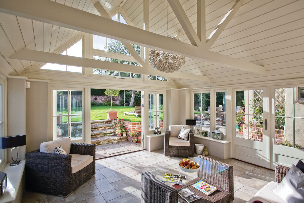 Sunroom - traditional beige floor sunroom idea in Essex with no fireplace and a standard ceiling
