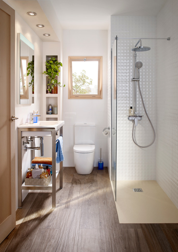 Inspiration for a small contemporary 3/4 white tile dark wood floor bathroom remodel in Barcelona with open cabinets, a two-piece toilet, white walls and a console sink