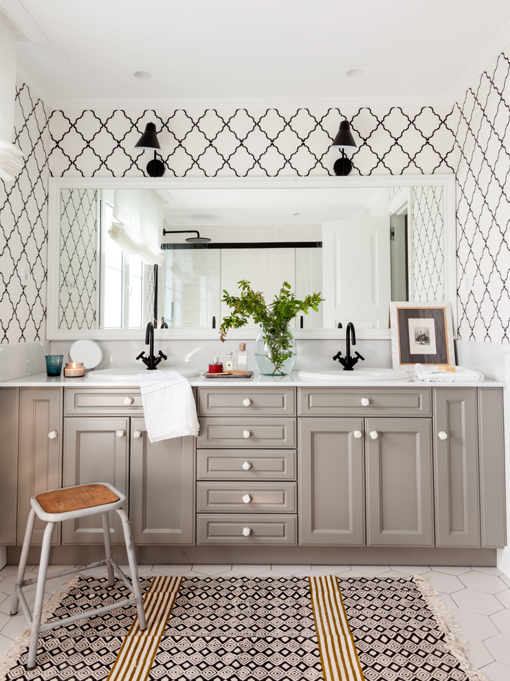 Bathroom - transitional white floor bathroom idea in Bilbao with beaded inset cabinets, gray cabinets, white walls, a drop-in sink and white countertops