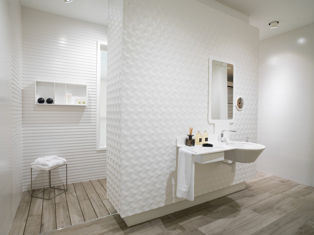 Inspiration for a mid-sized contemporary master medium tone wood floor doorless shower remodel in Other with white walls and a wall-mount sink
