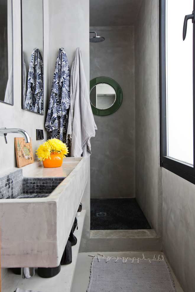 Example of a small trendy 3/4 gray tile gray floor and concrete floor bathroom design in Barcelona with open cabinets, gray cabinets, gray walls, concrete countertops, gray countertops and a wall-mount sink