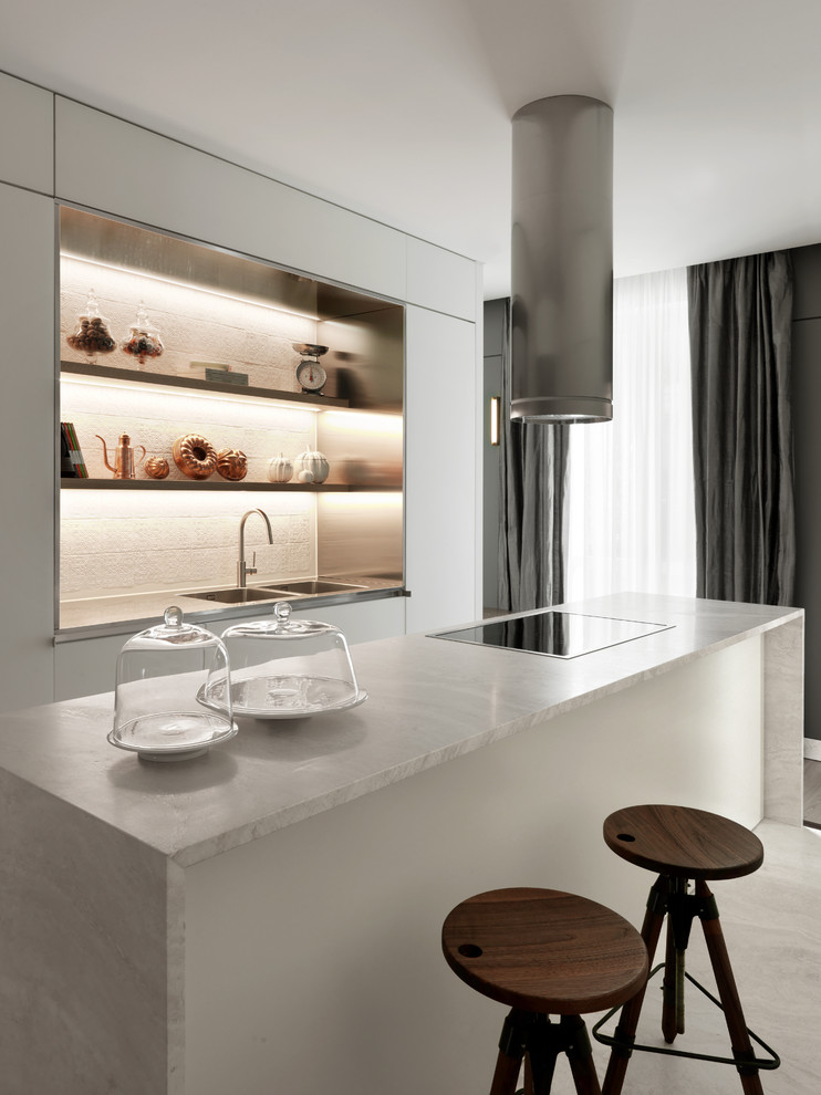 Example of a trendy single-wall white floor kitchen design in Milan with a double-bowl sink, white cabinets, an island, open cabinets, marble countertops, white backsplash and white countertops