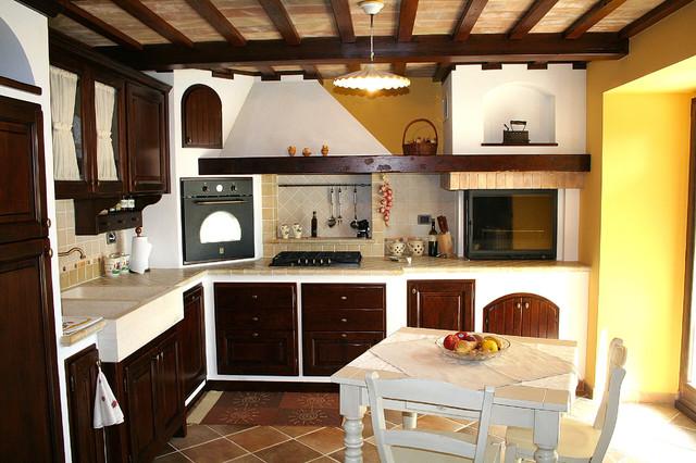 Cucina e soggiorno in tavernetta - Piastrelle taverna ...