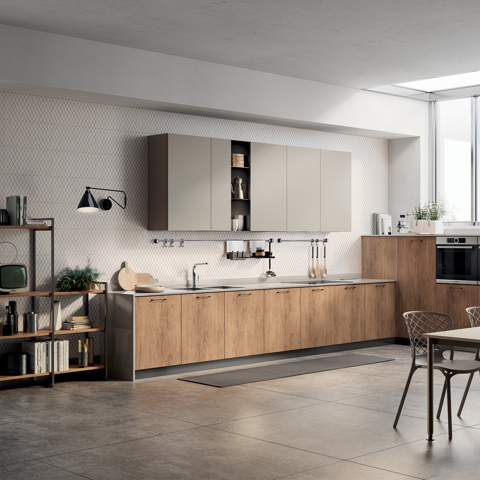Example of a mid-sized minimalist l-shaped open concept kitchen design in Other with a double-bowl sink, flat-panel cabinets, quartz countertops, stainless steel appliances, no island and gray countertops