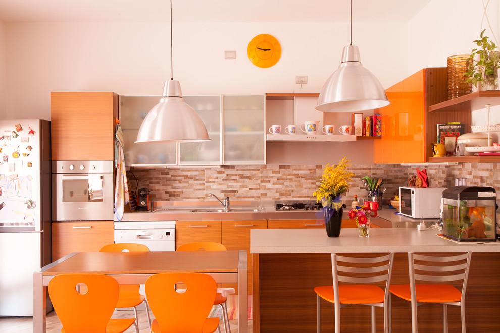 Example of a mid-sized trendy u-shaped porcelain tile open concept kitchen design in Milan with a drop-in sink, orange cabinets, porcelain backsplash, an island, flat-panel cabinets and orange backsplash