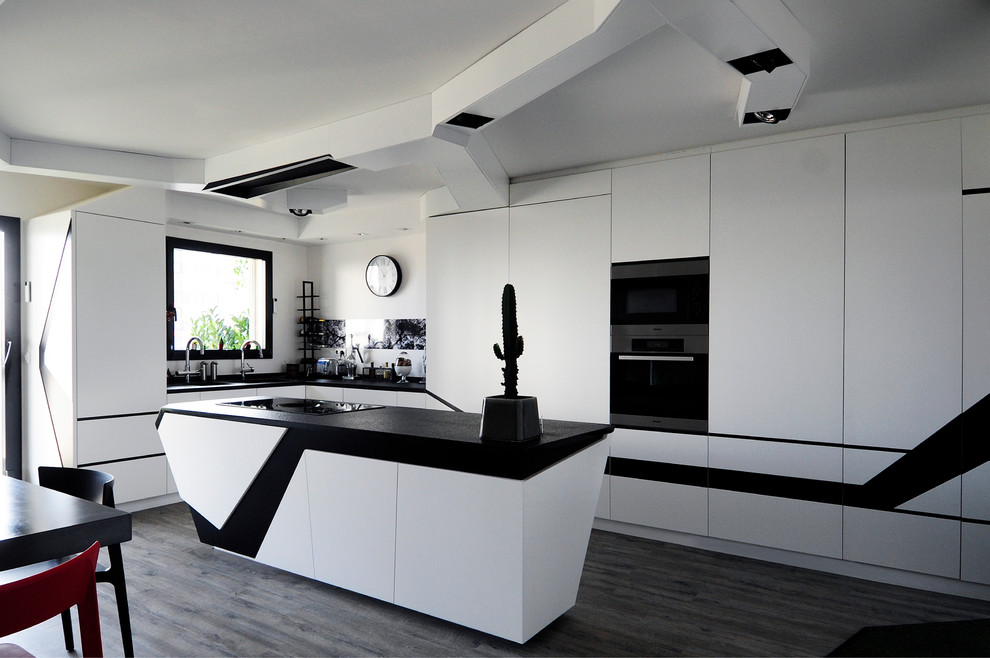 Open concept kitchen - large contemporary l-shaped open concept kitchen idea in Paris with white cabinets and an island