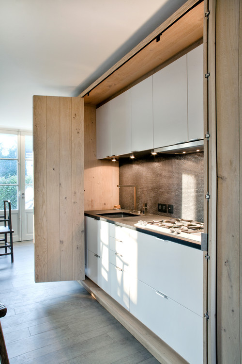 If minimalism is your thing, you're going to want to check out these hidden kitchens