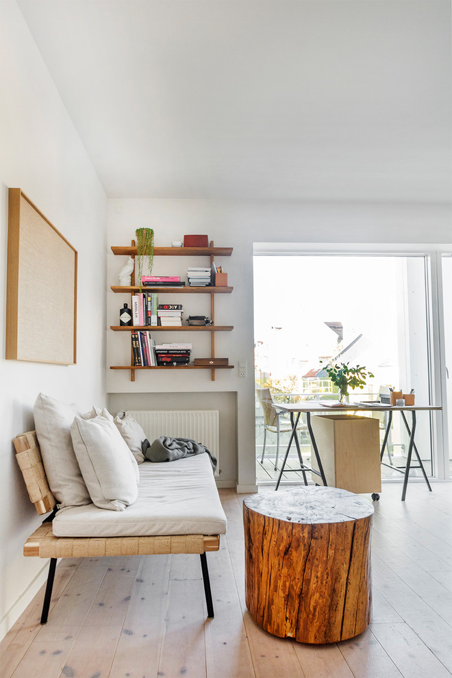 Mid-sized danish enclosed light wood floor and beige floor living room photo with white walls and no fireplace