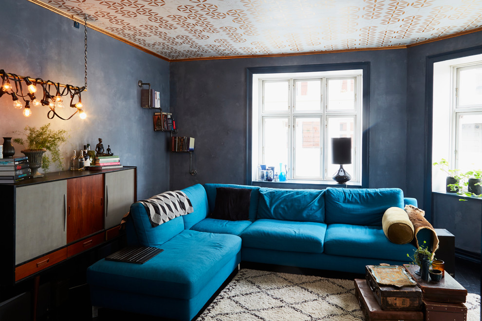 Inspiration for an industrial enclosed living room remodel in Copenhagen with black walls