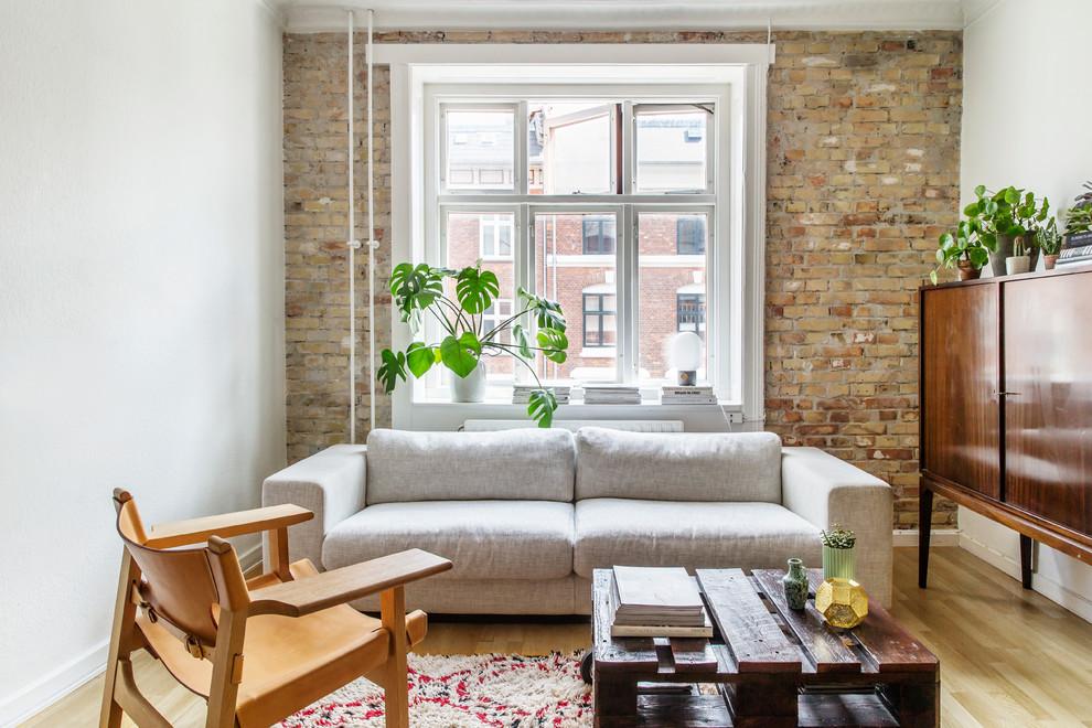 Living room - scandinavian formal and enclosed light wood floor living room idea in Copenhagen with white walls