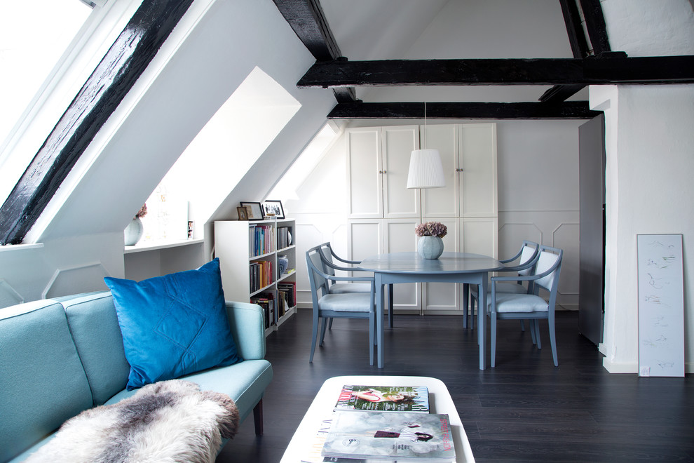 Living room - mid-sized scandinavian formal and open concept dark wood floor living room idea in Copenhagen with white walls, no fireplace and no tv