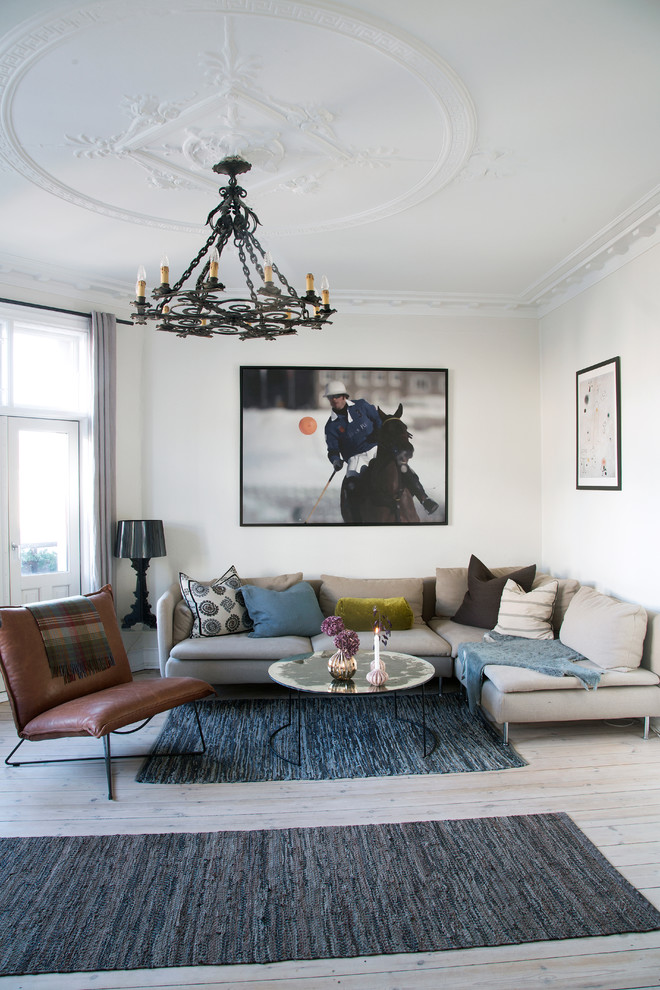Large danish formal and enclosed light wood floor living room photo in Copenhagen with white walls, no fireplace and no tv