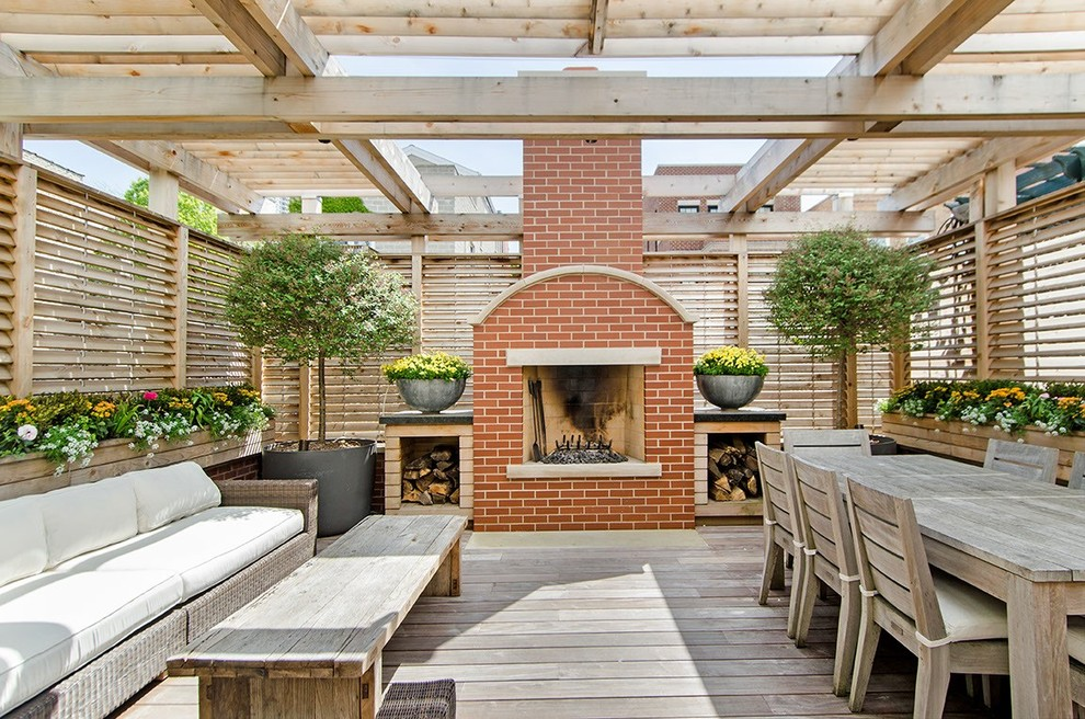 Inspiration for a timeless deck remodel in Chicago with a fire pit and a pergola