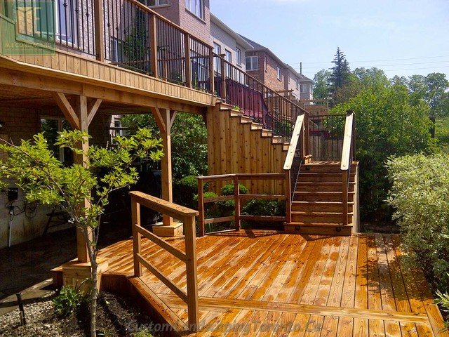 2 level deck with basement walkout and pergola Walkout basement deck designs