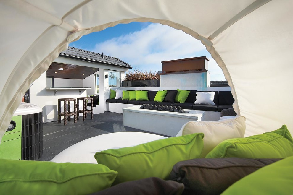 Inspiration for a contemporary rooftop deck remodel in Los Angeles with a fire pit