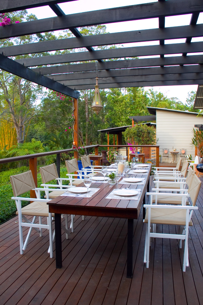 Mid-sized transitional backyard deck photo in Sunshine Coast with a pergola