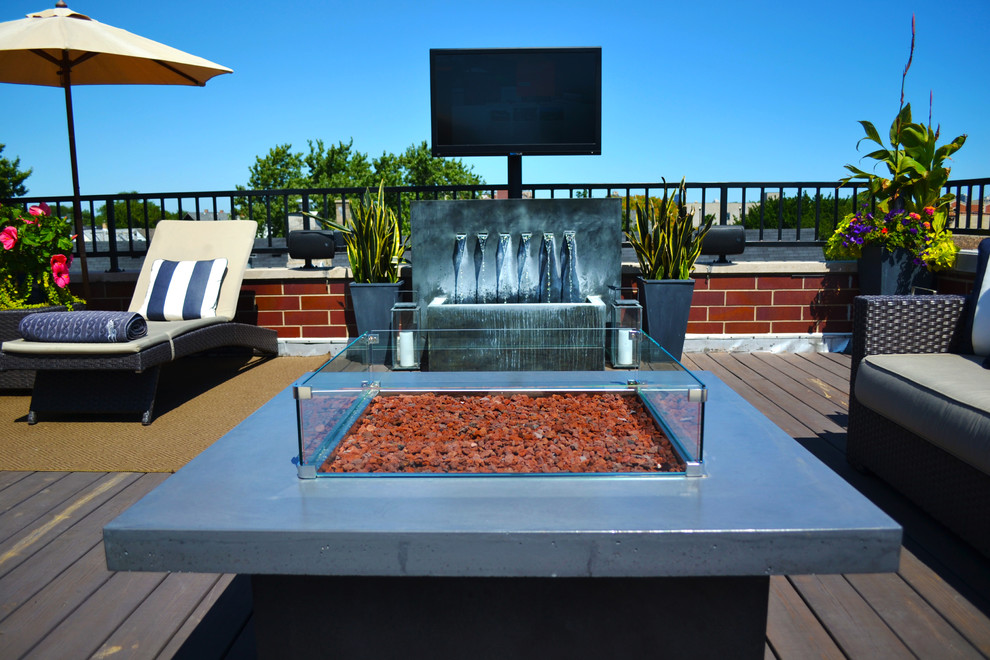 Large trendy rooftop deck photo in Chicago with a fire pit and no cover