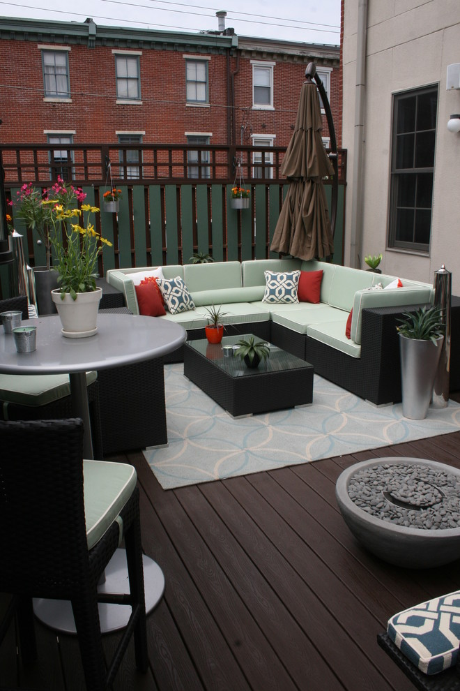 Transitional deck photo in Philadelphia with a fire pit