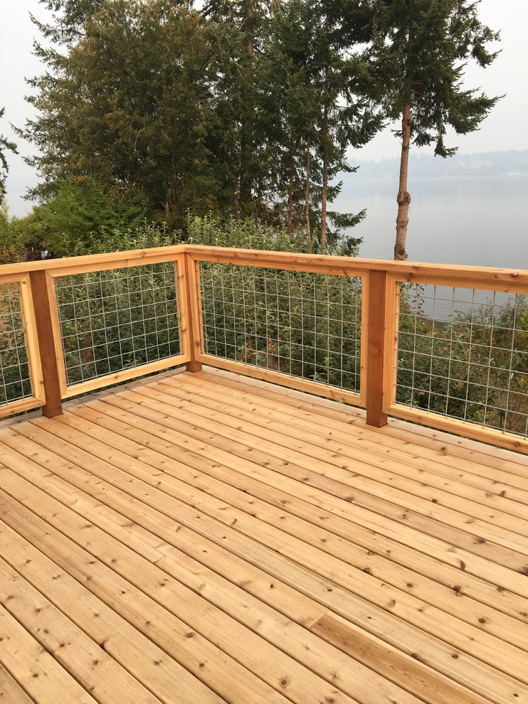 Example of a beach style deck design in Seattle