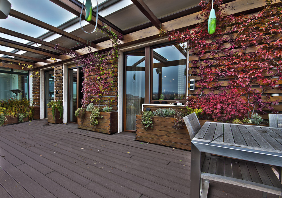 Deck container garden - large contemporary rooftop deck container garden idea in Turin with a pergola