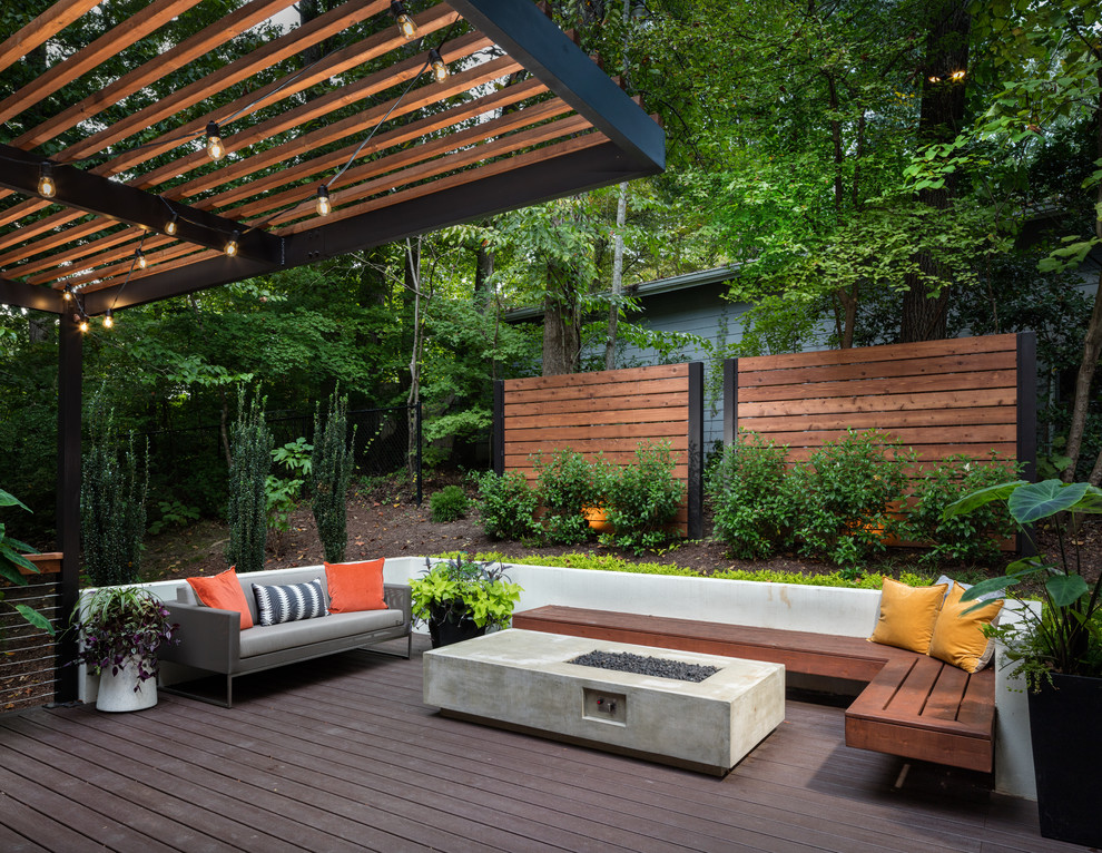 Inspiration for a large contemporary backyard deck remodel in Atlanta with a fire pit and a pergola
