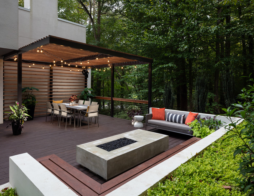 Large trendy backyard deck photo in Atlanta with a fire pit and a pergola