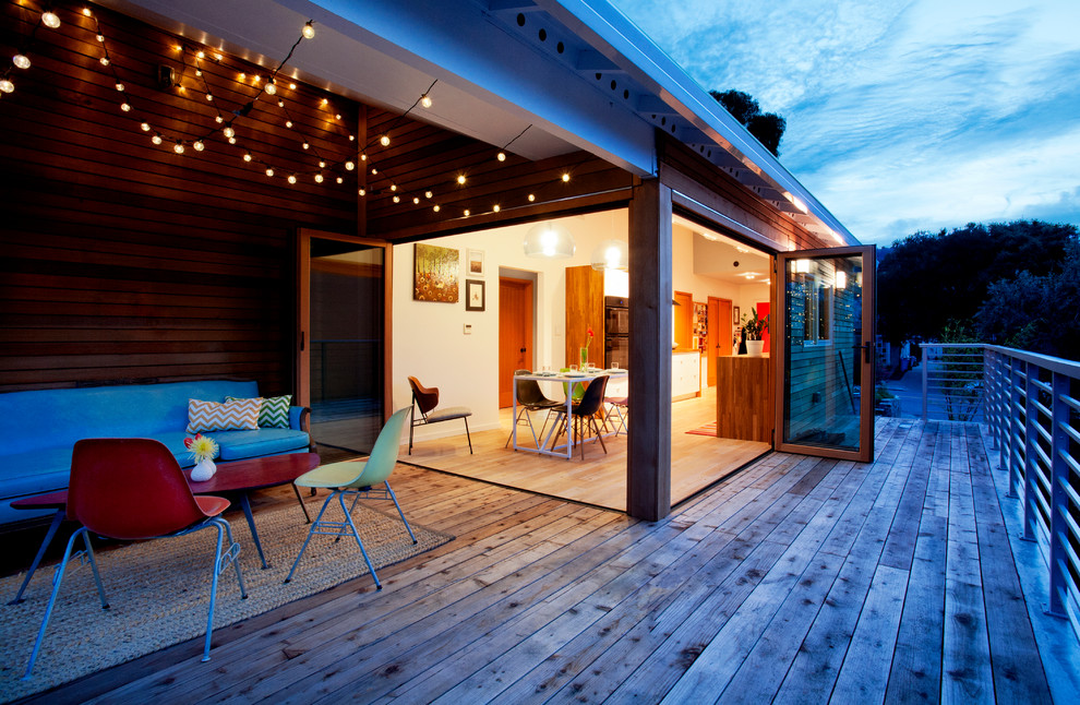 Example of a trendy deck design in San Francisco with a pergola
