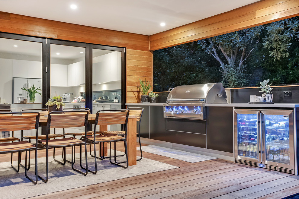 Outdoor kitchen deck - coastal outdoor kitchen deck idea in Melbourne with a roof extension