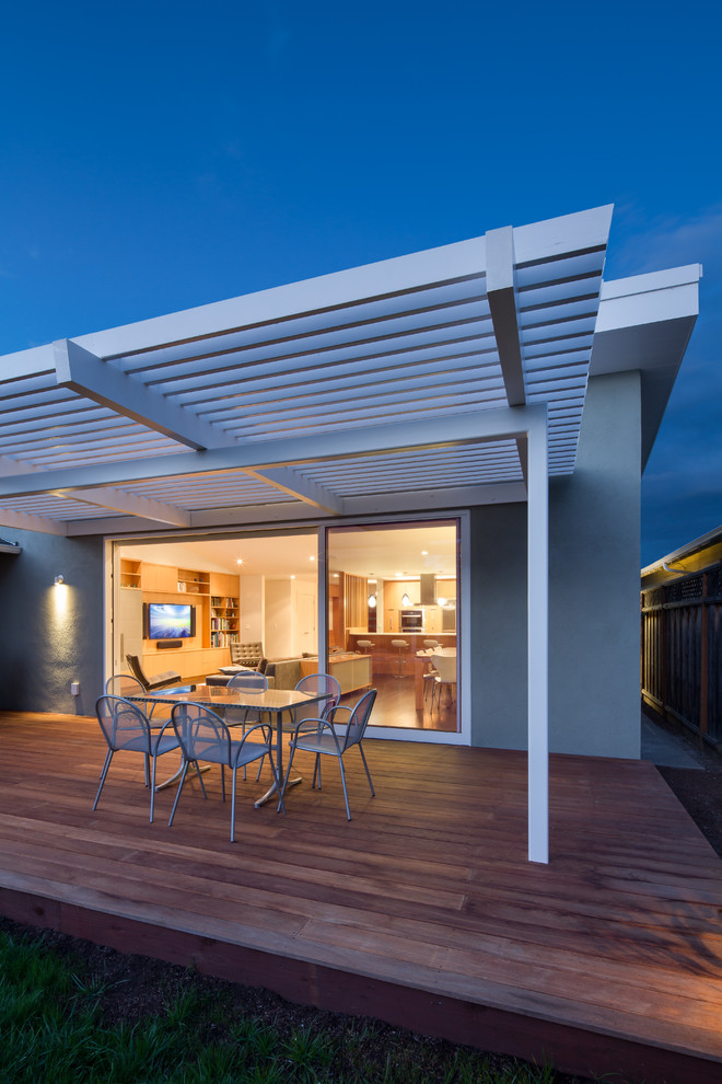 Example of a mid-sized 1960s backyard deck design in San Francisco with a pergola