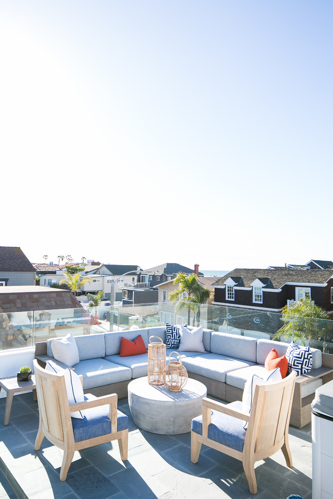 Example of a beach style rooftop rooftop deck design in Orange County with no cover