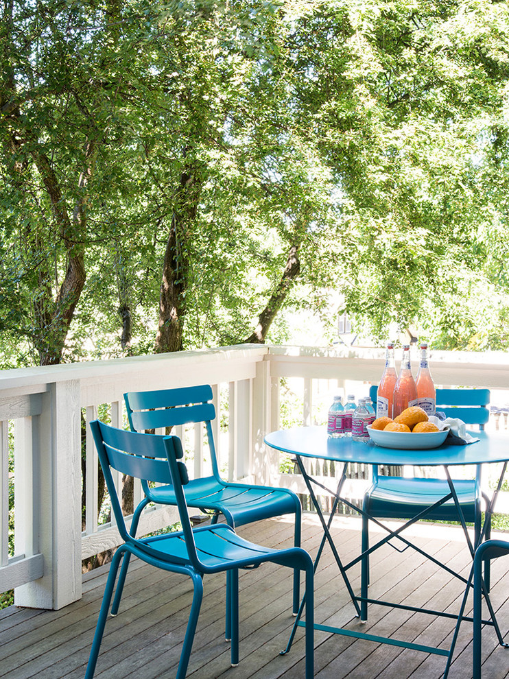 Small transitional side yard deck photo in Seattle with no cover