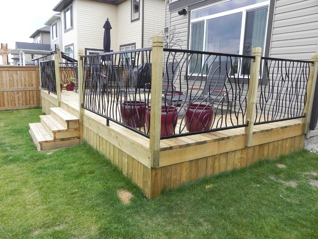 Custom Backyard Deck Designs : BENT railing design on a custom outdoor deck  Modern  Deck  calgary