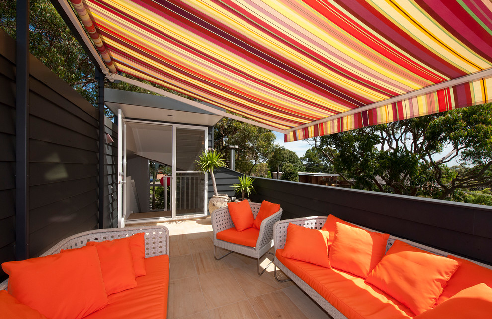 Inspiration for a mid-sized contemporary rooftop rooftop deck remodel in Sydney with an awning