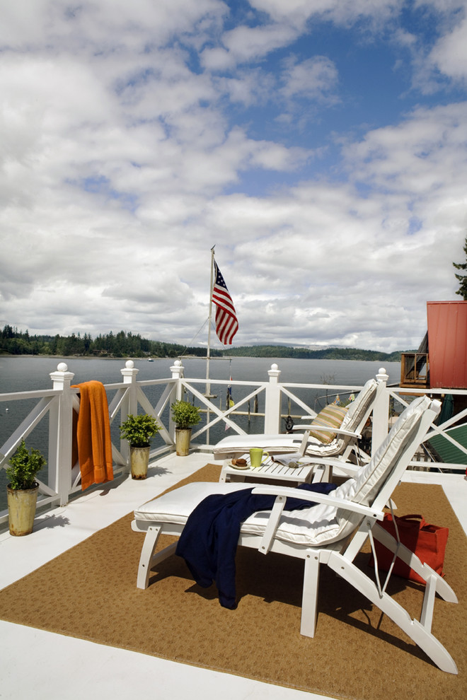 Example of a beach style deck design in Portland with no cover