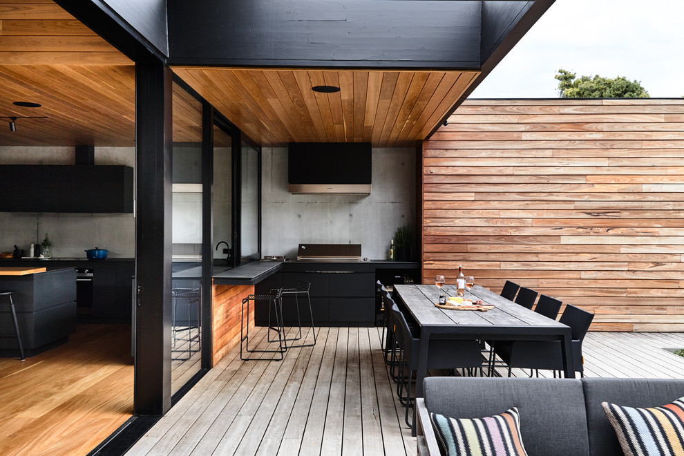 Deck - mid-sized contemporary backyard deck idea in Melbourne with a roof extension