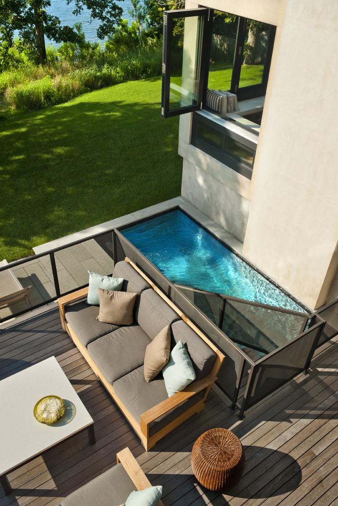 Example of a beach style deck design in New York with no cover