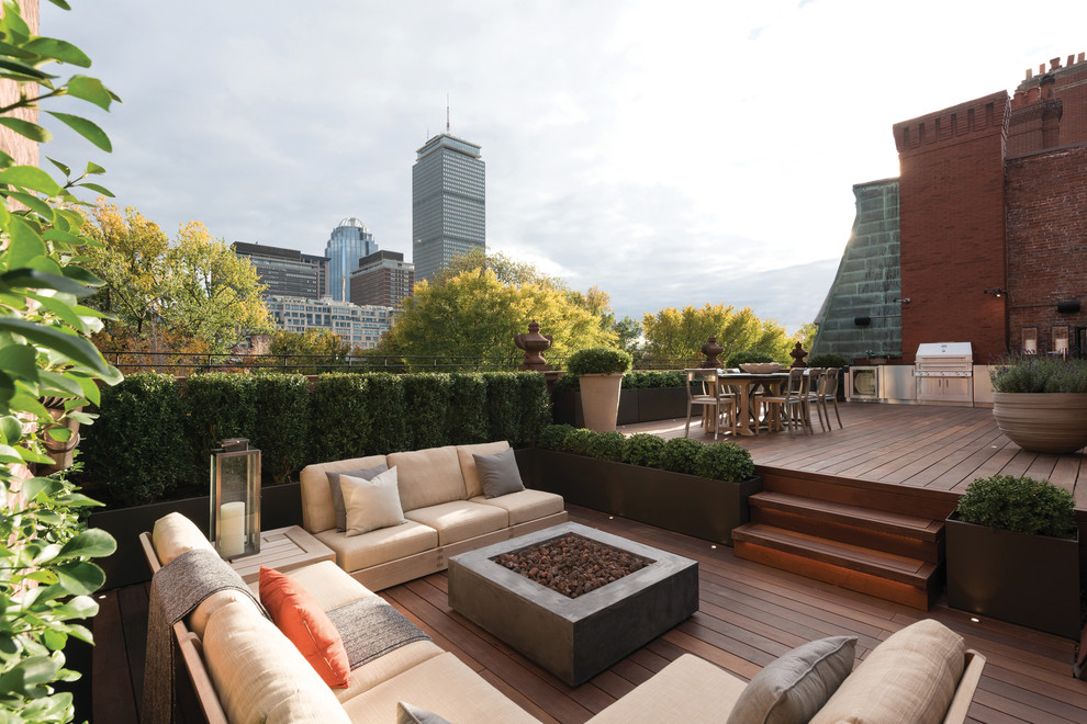 Example of a huge classic rooftop rooftop outdoor kitchen deck design in Boston with no cover