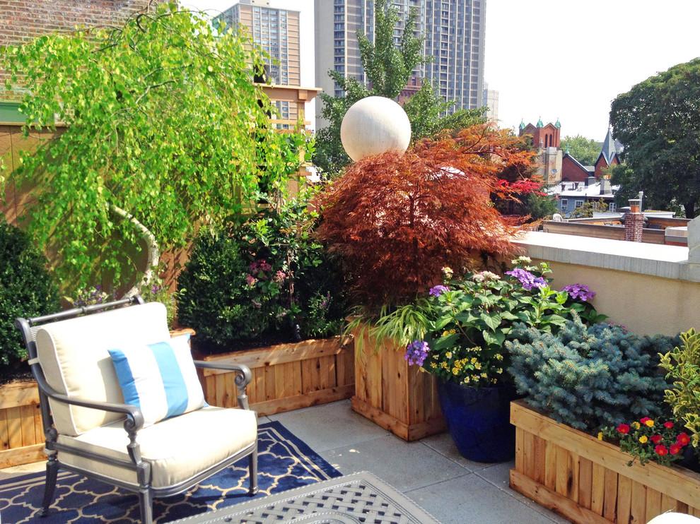 Elegant rooftop deck container garden photo in New York