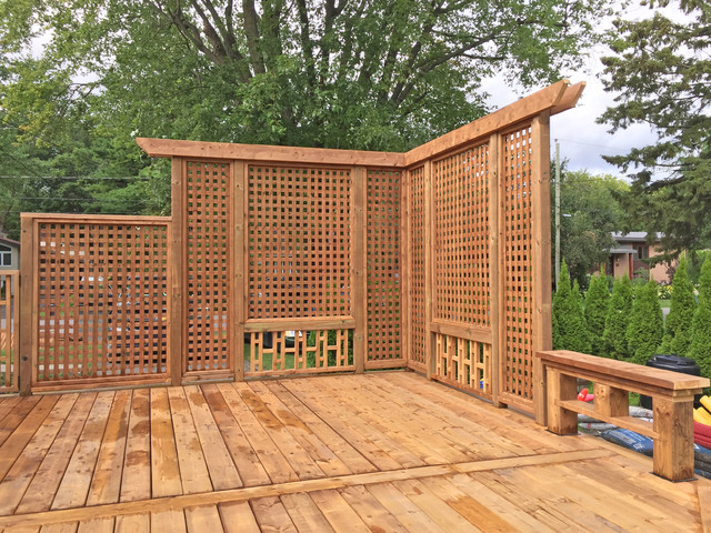 Brown Treated Wood Deck With Custom Privacy Wall And Custom Bench