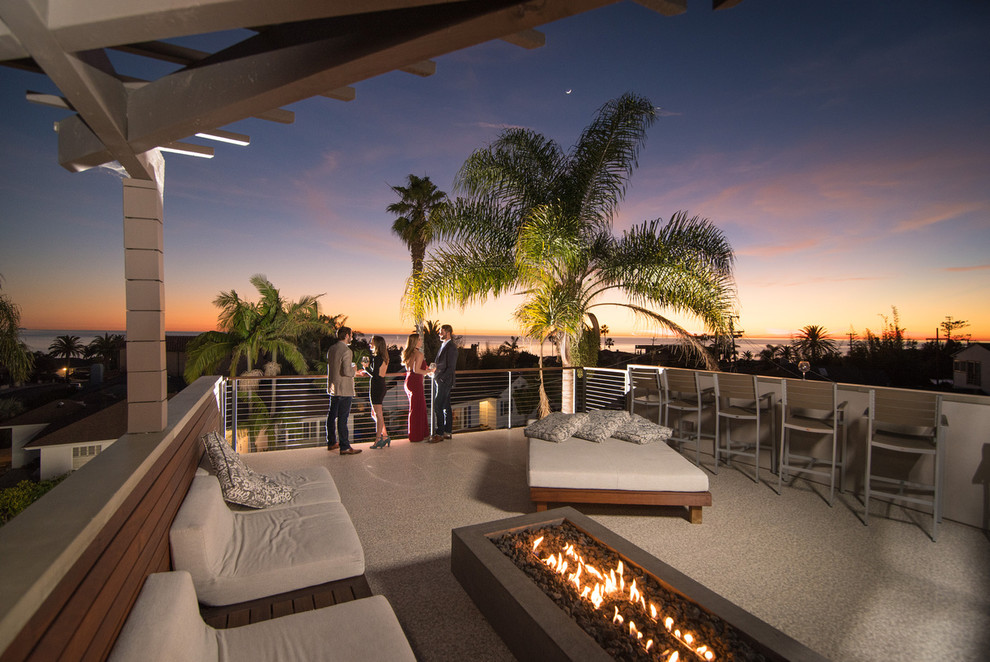 Inspiration for a mid-sized modern rooftop deck remodel in San Diego with a fire pit and a pergola